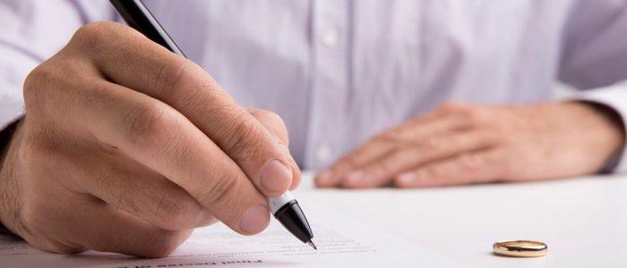 husband-sign-divorce-decree-ending-relationships-w-RJJWXRH (1)