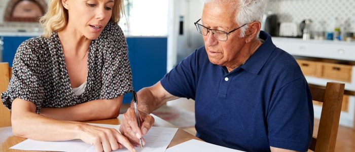 woman-helping-senior-man-to-complete-last-will-and-LN7TBUY (1)